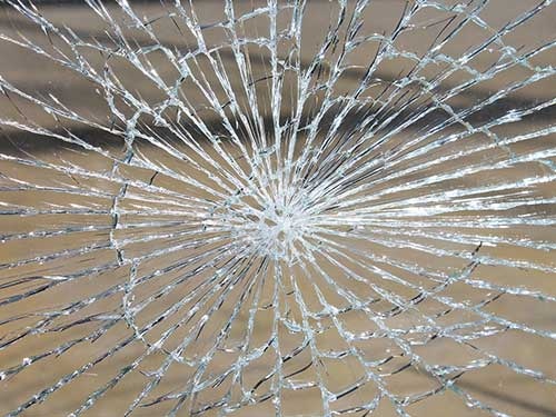 Broken glass that resembles a spiderweb